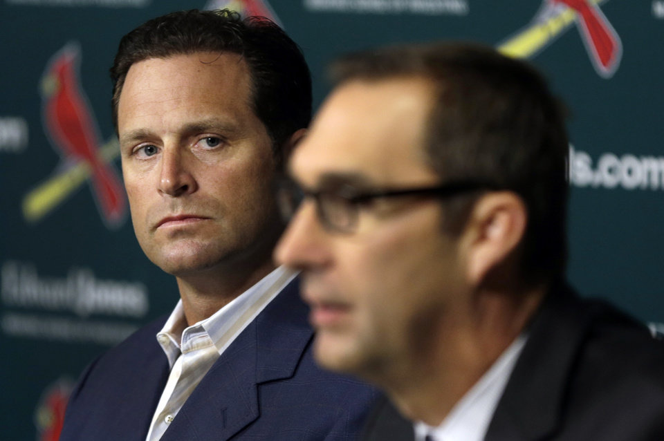 St. Louis Cardinals manager Mike Matheny, left, listens as general manager John Mozeliak talks about the future of Cardinals pitcher Chris Carpenter during a baseball  news conference Tuesday, Feb. 5, 2013, in St. Louis. The Cardinals announced Carpenter will not pitch in the 2013 season and his future with the club is uncertain due to a lingering injury. (AP Photo/Jeff Roberson)