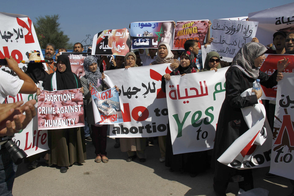 Photo -   Moroccan women protest the scheduled arrival of a Dutch ship advocating safe and legal abortions in Smir, Morocco Thursday oct 4 2012. Their signs read