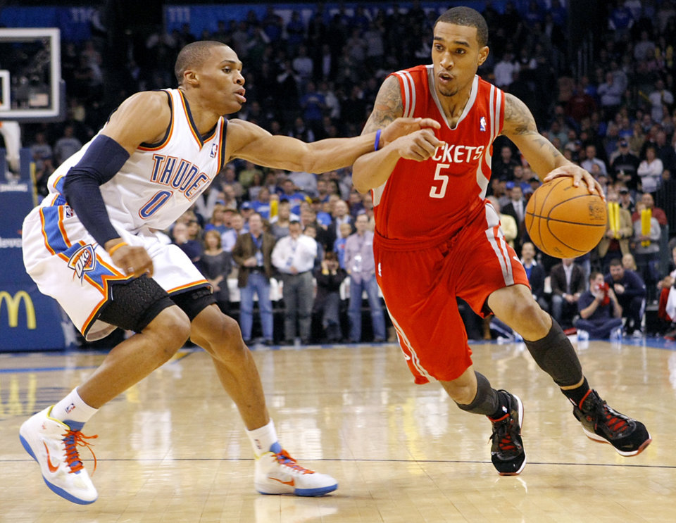 Photo - Oklahoma City's Russell Westbrook pressures Houston's Courtney Lee during their NBA basketball game at the OKC Arena in downtown Oklahoma City on Wednesday, Nov. 17, 2010. Photo by John Clanton, The Oklahoman