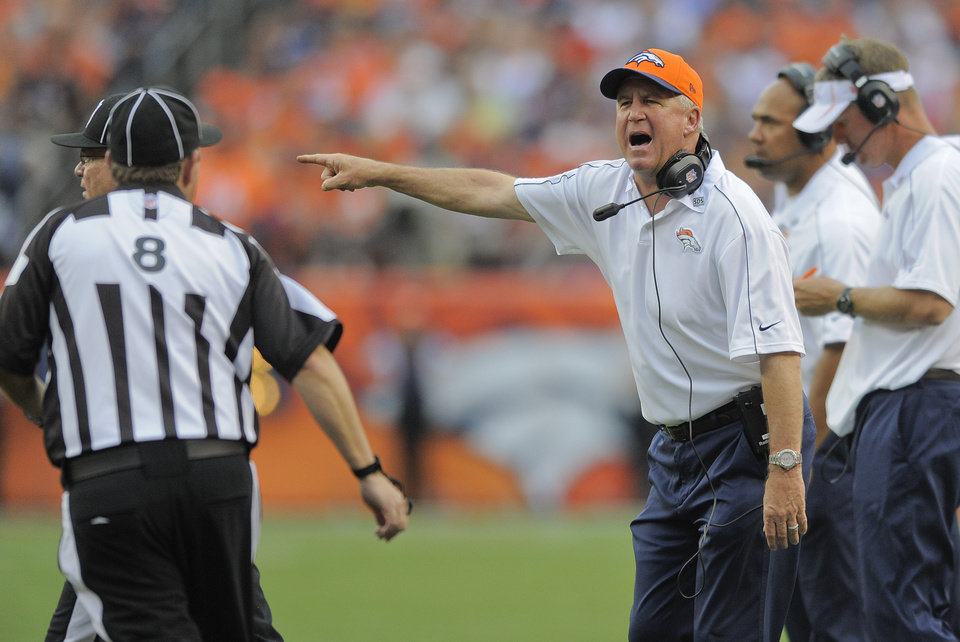 Photo -   Denver Broncos head coach John Fox, right, shouts to the referee in the fourth quarter of an NFL football game against the Houston Texans, Sunday, Sept. 23, 2012, in Denver. (AP Photo/Jack Dempsey)