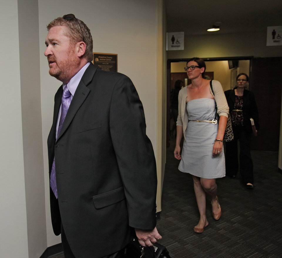 Photo -   Defense attorney Daniel King leads other public defenders into court for a motions hearing for suspected movie theater shooter James Holmes in district court in Centennial, Colo., on Thursday, Aug. 30, 2012. Holmes has been charged in the shooting at the Aurora theater on July 20 that killed twelve people and injured more than 50. (AP Photo/Barry Gutierrez)