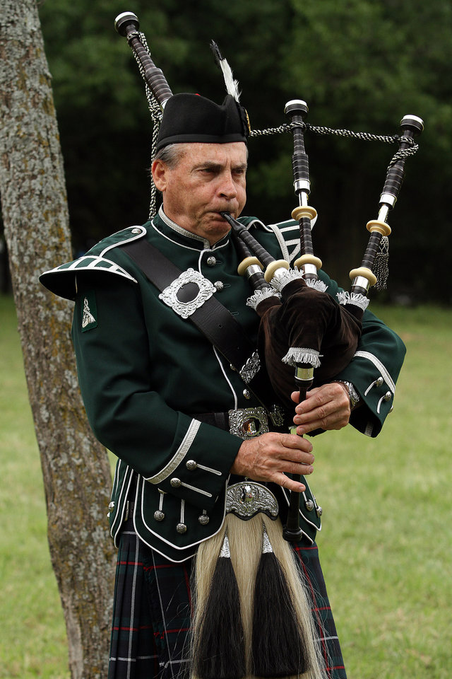 Photo - Jim Jewell of Oklahoma City plays the bag pipes during the Iron Thistle Festival in Yukon, Saturday, April 28th, 2012. PHOTO BY HUGH SCOTT, FOR THE OKLAHOMAN  ORG XMIT: KOD
