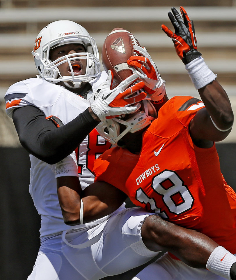 Oklahoma State's Blake Jackson, left, catches the ball but is unable to hold on beside Deion Imade during OSU's spring football game at Boone Pickens Stadium in Stillwater, Okla., Sat., April 20, 2013. Photo by Bryan Terry, The Oklahoman