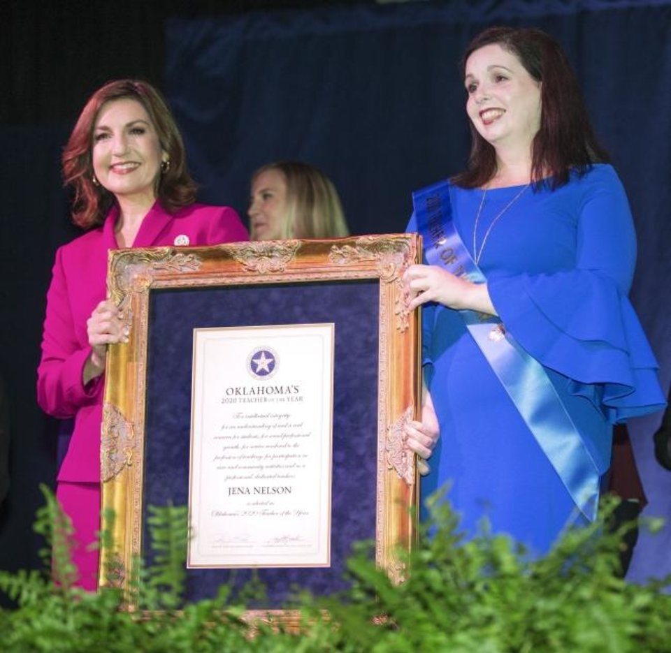 Photo -  Joy Hofmeister, State Superintendent of Public Instruction, left, and Jena Nelson, a Deer Creek Middle School teacher, pose for a photo after Nelson was named the Oklahoma Teacher of the Year at the State Fair Park on Tuesday. [Nate Billings/The Oklahoman]