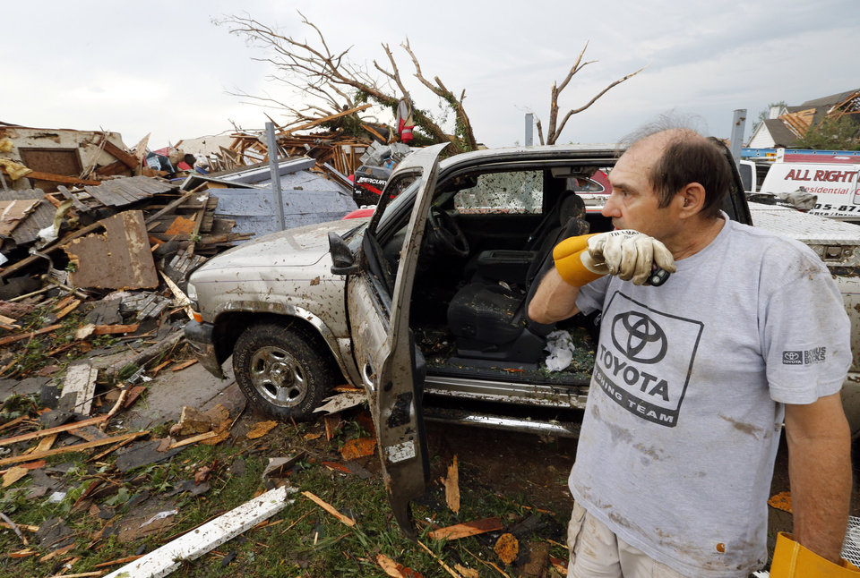 Allen Anderson surveys the damage to his home near SW 149th and Western on Monday, May 20, 2013  in Moore, Okla. Photo by Steve Sisney, The Oklahoman