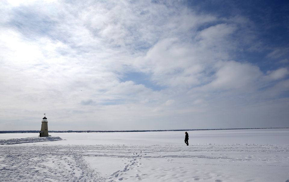 Photo - A person walks at Lake Hefner in Oklahoma City, Wednesday, Feb. 17, 2021. [Sarah Phipps/The Oklahoman]