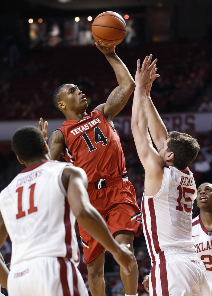 Photo - Texas Tech guard Robert Turner (14) goes up for a shot in front of Oklahoma guard Isaiah Cousins (11) and forward Tyler Neal (15) during the first half of an NCAA college basketball game in Norman, Okla., Wednesday, Feb. 12, 2014. Texas Tech won 68-60. (AP Photo/Sue Ogrocki)