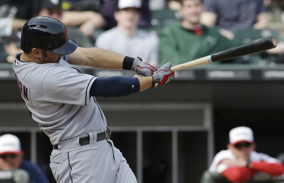 Photo - Cleveland Indians' Ryan Raburn hits a two-run single against the Chicago White Sox during the seventh inning of a baseball game in Chicago on Saturday, April 12, 2014. (AP Photo/Nam Y. Huh)