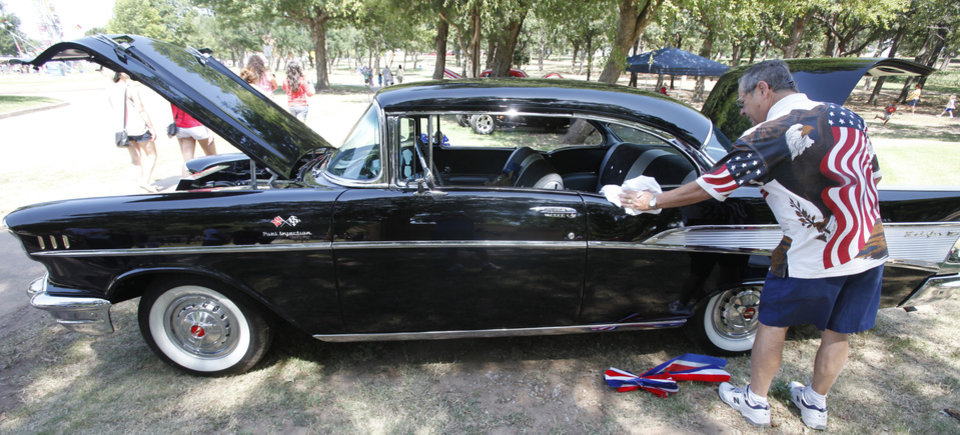 Jerry Webb polishes his 1957 Chevy  during Freedom Festival at Eldon Lyon Park in Bethany, Wednesday, July 4, 2012. Photo By Steve Gooch, The Oklahoman