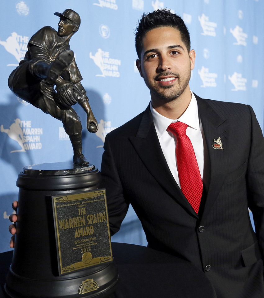 Photo - Gio Gonzalez of the Washington Nationals, winner of the 2012 Warren Spahn Award, poses for a photo with the award at a press conference at the Jim Thorpe Museum and Oklahoma Sports Hall of Fame in Oklahoma City, Thursday, Jan. 17, 2013. The Warren Spahn Award honors the best left-handed pitcher in Major League Baseball. Photo by Nate Billings, The Oklahoman