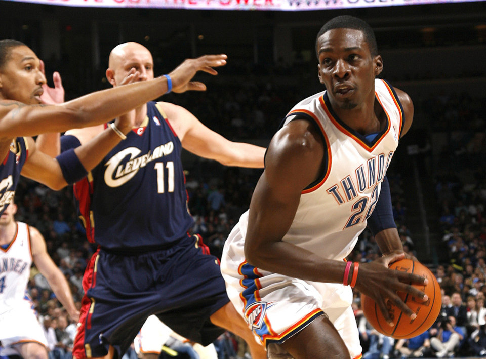 Photo - Oklahoma City's Jeff Green (22) looks to pass the ball during the NBA game between the Oklahoma City Thunder and the Cleveland Cavaliers, Sunday, Dec. 13, 2009, at the Ford Center in Oklahoma City. Photo by Sarah Phipps, The Oklahoman