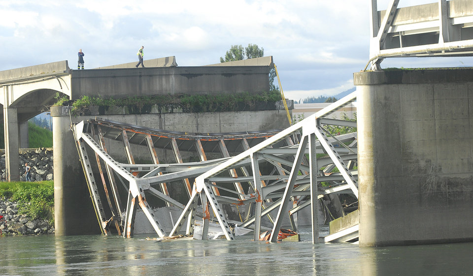 Photo - A portion of the Interstate 5 bridge is submerged after it collapsed into the Skagit River dumping vehicles and people into the water in Mount Vernon, Wash., Thursday, May 23, 2013 according to the Washington State Patrol. (AP Photo/Skagit Valley Herald, Frank Varga)