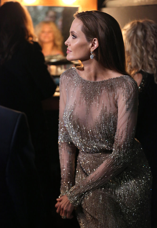 Photo - Angelina Jolie appears backstage during the Oscars at the Dolby Theatre on Sunday, March 2, 2014, in Los Angeles.  (Photo by Matt Sayles/Invision/AP)