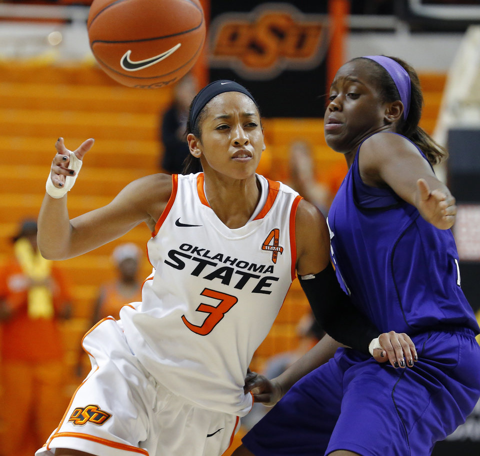Photo - Oklahoma State's Tiffany Bias (3) passes the ball around Stephen F. Austin's Brittney Matthew (1) during a women's college basketball game between Oklahoma State University and Stephen F. Austin at Gallagher-Iba Arena in Stillwater, Okla., Thursday, Dec. 6, 2012.  Photo by Bryan Terry, The Oklahoman