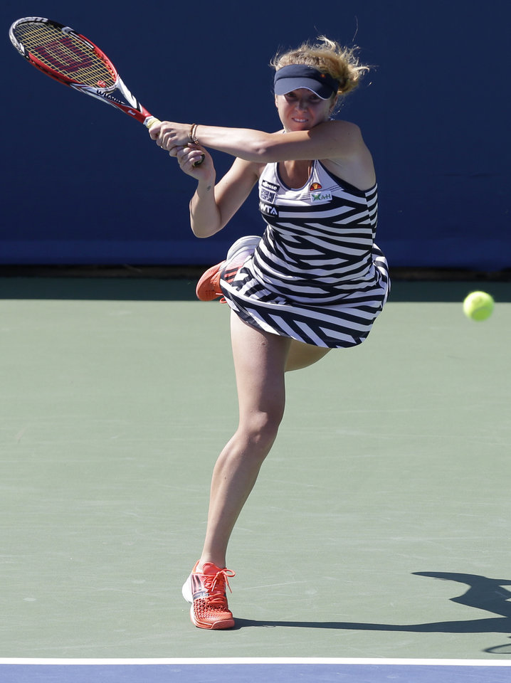 Photo - Elina Svitolina, from Ukraine, hits a forehand against Petra Kvitova, from Czech Republic, during a match at the Western & Southern Open tennis tournament, Wednesday, Aug. 13, 2014, in Mason, Ohio. (AP Photo/Al Behrman)