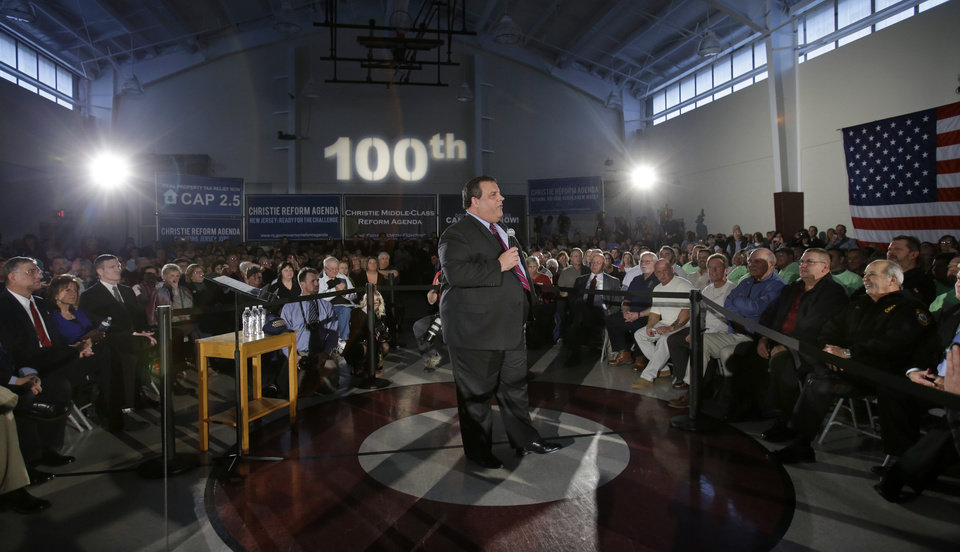 Photo - New Jersey Gov. Chris Christie addresses an overflow crowd at Saint Mary's of The Pines Church Parish Wednesday, Jan.16, 2013, in Manahawkin, N.J., as he returned to the Jersey Shore for his 100th town hall. The 2-square-mile community of 2,300 people in Ocean County is the gateway to Long Beach Island, an area hit hard by Superstorm Sandy. (AP Photo/Mel Evans)