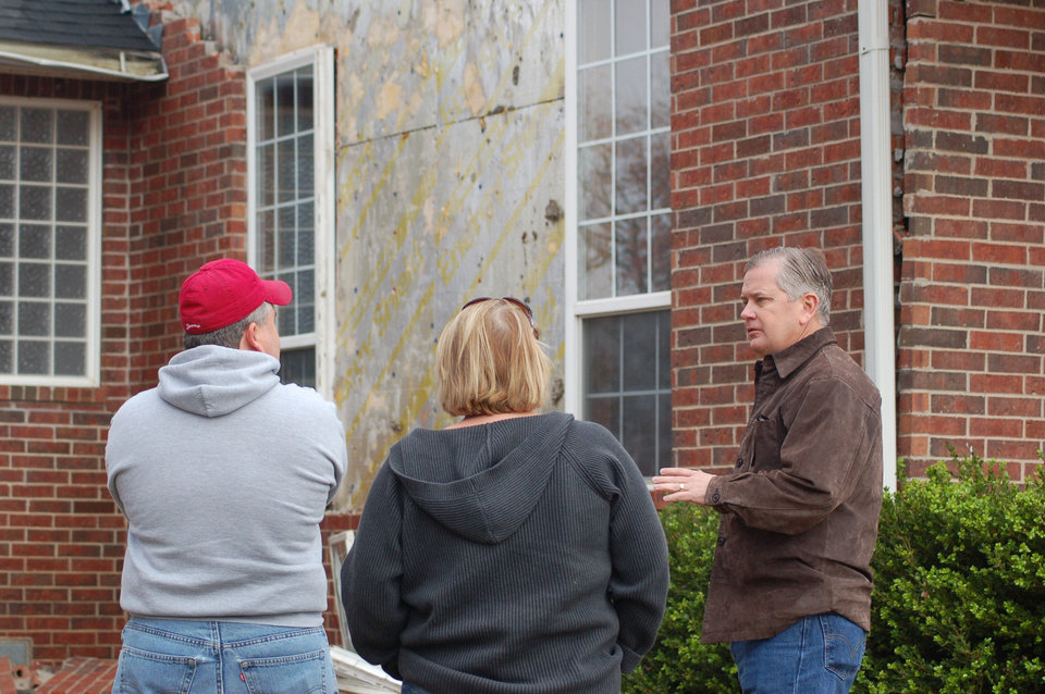 Photo - Insurance Commissioner visits Lincoln County after a 5.6-magnitude earthquake there in November 2011.