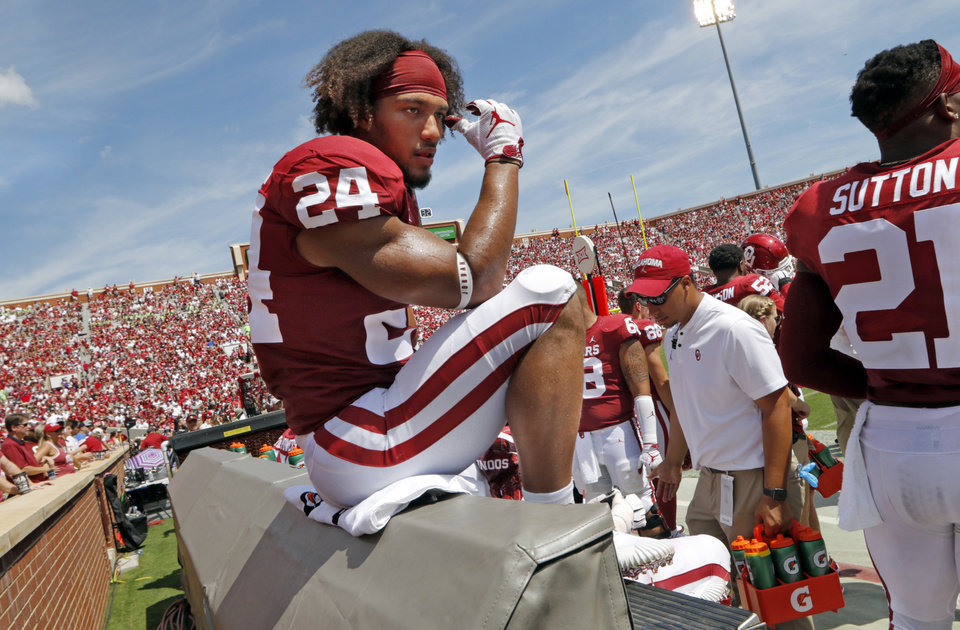 Photo - Oklahoma's Rodney Anderson (24) rests on the sidelines during a college football game between the University of Oklahoma Sooners (OU) and the Florida Atlantic Owls (FAU) at Gaylord Family-Oklahoma Memorial Stadium in Norman, Okla., on Saturday, Sept. 1, 2018. Photo by Steve Sisney, The Oklahoman
