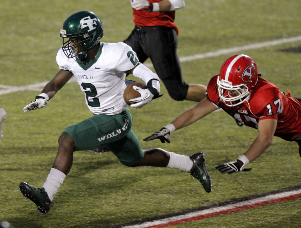 Edmond Santa Fe's Trevan Smith runs past Yukon's Jessy Brown during a high school football game in Yukon, Okla., Friday, Sept. 9, 2011. Photo by Bryan Terry, The Oklahoman