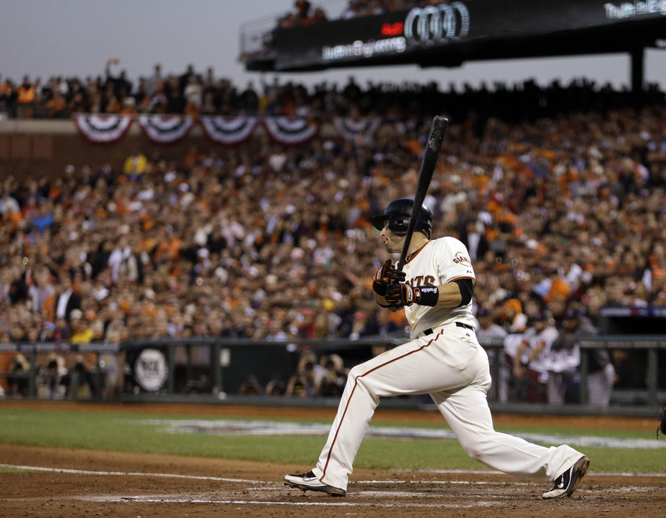 Photo -   San Francisco Giants' Marco Scutaro watches his three RBI hit during the fourth inning of Game 2 of baseball's National League championship series against the St. Louis Cardinals Monday, Oct. 15, 2012, in San Francisco. (AP Photo/Ben Margot)