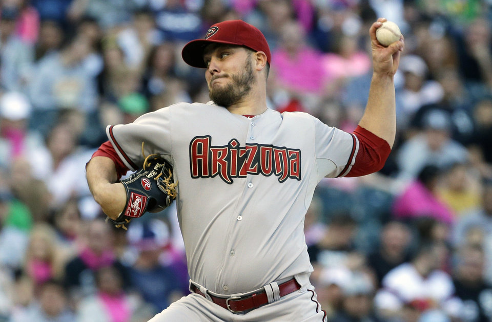 Photo - Arizona Diamondbacks starter Wade Miley throws against the Chicago White Sox during the first inning of an interleague baseball game in Chicago, Saturday, May 10, 2014. (AP Photo/Nam Y. Huh)