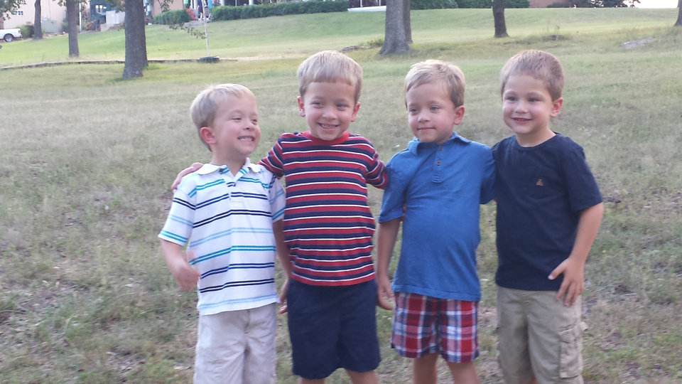 Photo -  Quadruplets Cooper, Allen, Logan and Wyatt Newby, 5, pose for a photo. Photo provided.