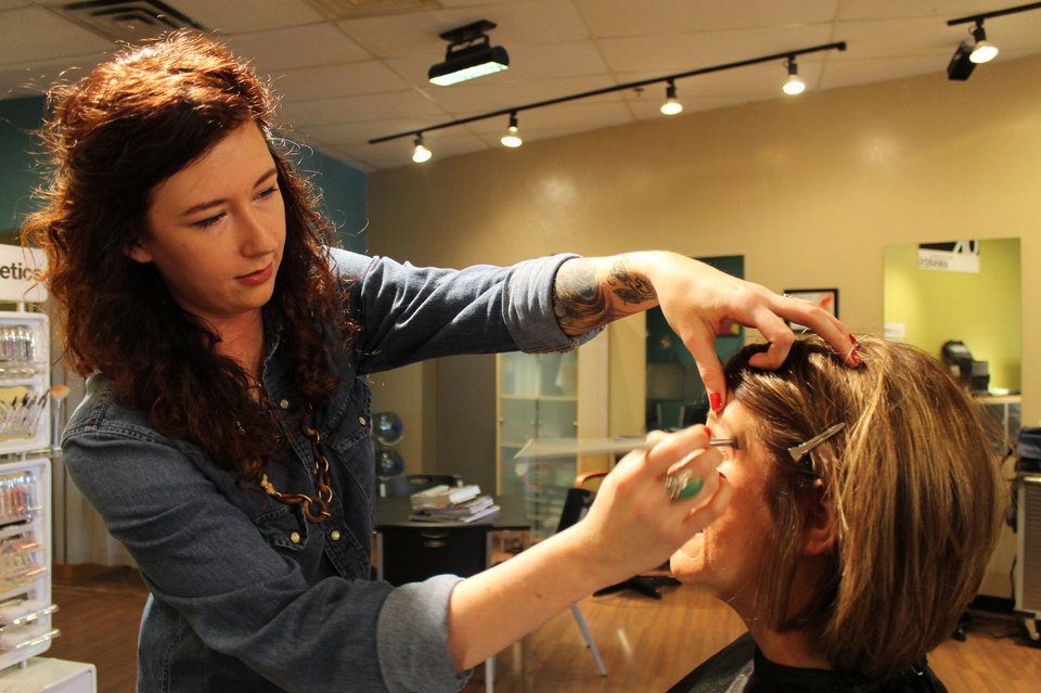 DK Salon makeup artist Ashley Johnson applies makeup to Lynn Bunting during her makeover. Photo by Heather Warlick, The Oklahoman. <strong></strong>