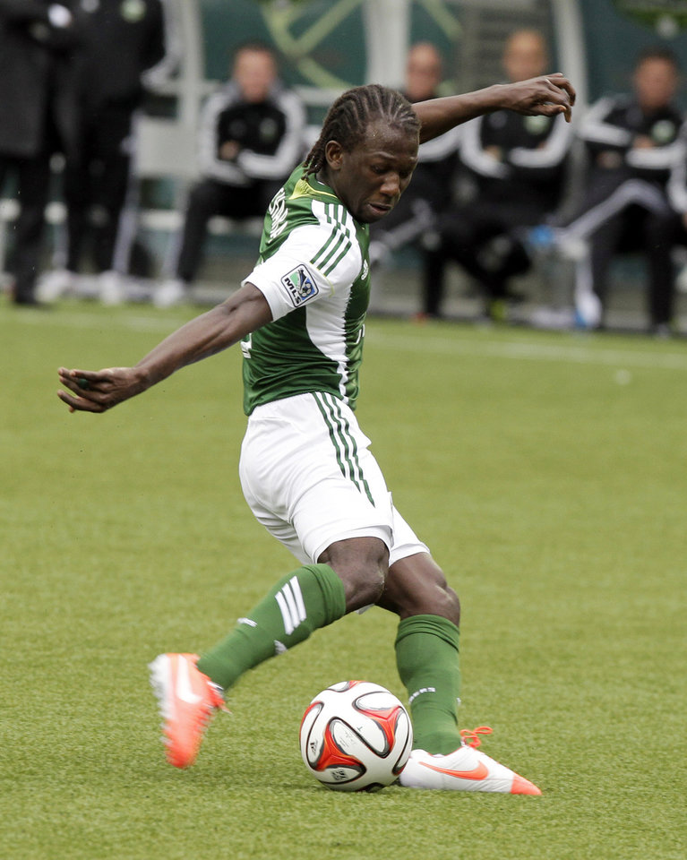 Photo - Portland Timbers midfielder Diego Chara shoots for a goal during the second half of an MLS soccer game against the Seattle Sounders in Portland, Ore., Saturday, April 5, 2014. Chara scored two goals as the teams tied 4-4. (AP Photo/Don Ryan)