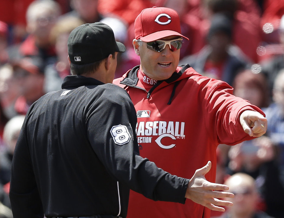 Photo - Cincinnati Reds manager Bryan Price argues a call with home plate umpire Quinn Wolcott (81) in the fifth inning of a baseball game against the Pittsburgh Pirates, Wednesday, April 16, 2014, in Cincinnati. Cincinnati won 4-0. (AP Photo/Al Behrman)