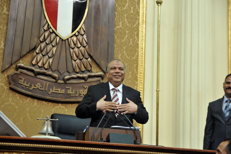 Photo -   Egyptian Parliament Speaker Saad el-Katani reacts during a brief session of Parliament, the first since the country's high court ruled the chamber unconstitutional, in Cairo, Egypt, Tuesday, July 10, 2012. Egypt's Islamist-dominated parliament convened Tuesday in defiance of a ruling by the country's highest court and swiftly voted to seek a legal opinion on the decision that invalidated the chamber over apparent election irregularities. (AP Photo)