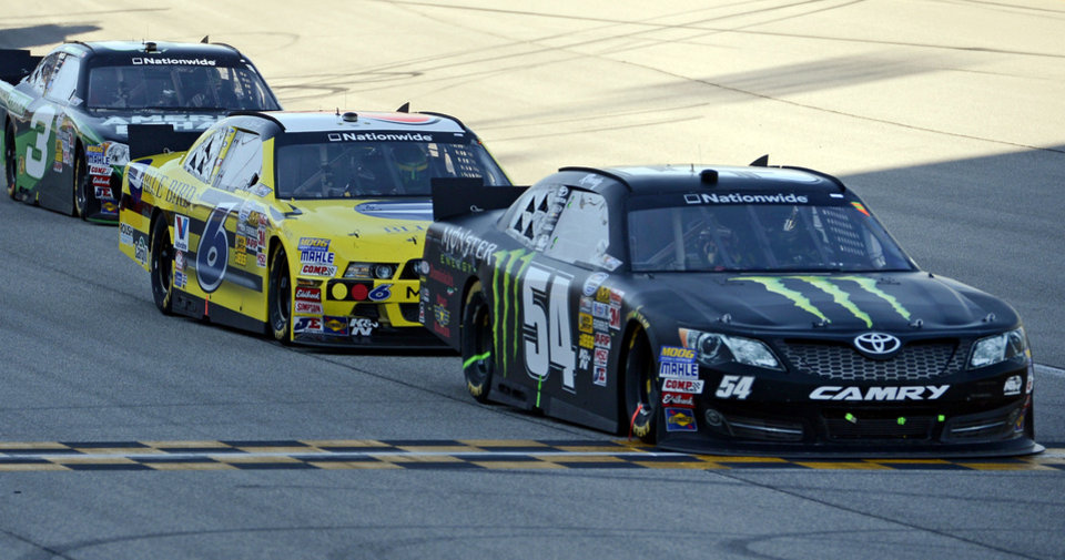 Photo -   Kyle Busch (54) leads Ricky Stenhouse Jr. (6), and Austin Dillon (3) during the NASCAR Nationwide Series auto race at Chicagoland Speedway in Joliet, Ill., Saturday, Sept. 15, 2012. (AP Photo/Warren Wimmer)