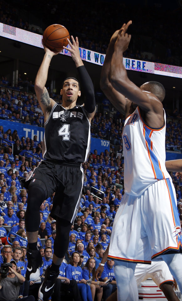 Photo - San Antonio's Danny Green (4) goes to the basket as Oklahoma City's Serge Ibaka (9) defends during Game 3 of the Western Conference Finals in the NBA playoffs between the Oklahoma City Thunder and the San Antonio Spurs at Chesapeake Energy Arena in Oklahoma City, Sunday, May 25, 2014. Photo by Bryan Terry, The Oklahoman