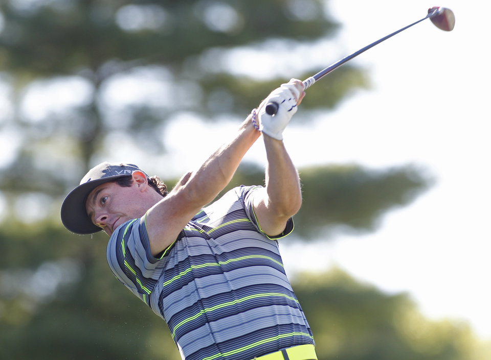 Photo - Rory McIlroy, of Northern Ireland, hits his tee shot on the tenth hole during the first round of the Deutsche Bank Championship golf tournament in Norton, Mass., Friday, Aug. 29, 2014. (AP Photo/Stew Milne)