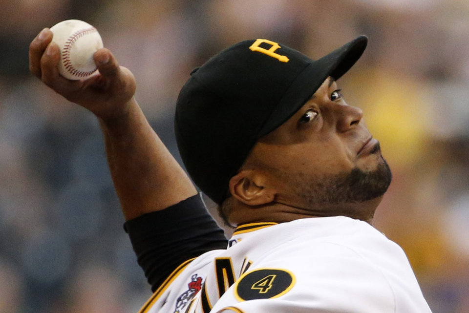 Photo - Pittsburgh Pirates starting pitcher Francisco Liriano delivers during the first inning of a baseball game against the Los Angeles Dodgers in Pittsburghm Wednesday, July 23, 2014. (AP Photo)