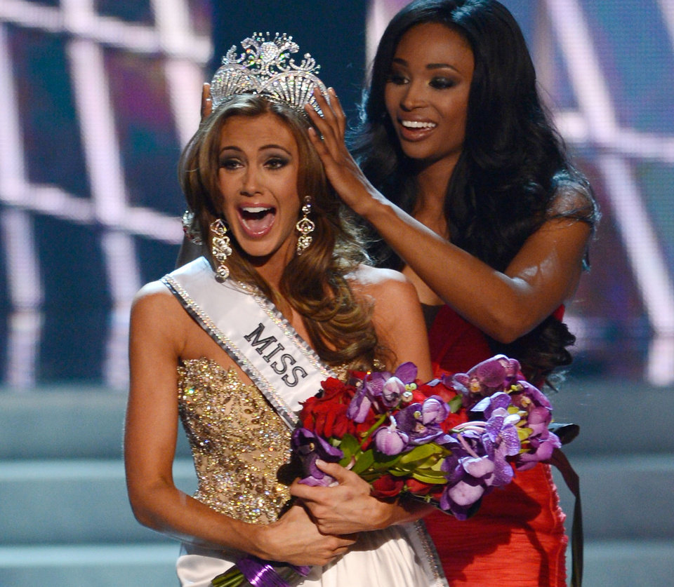 Photo - FILE - In this Sunday, June 16, 2013, file photo, Miss Connecticut Erin Brady is crowned the winner of the Miss USA 2013 pageant by Nana Meriwether in Las Vegas. Brady, of South Glastonbury, Conn., relinquishes her crown Sunday, June 8, 2014, when the 2014 pageant competition being held in Baton Rouge, La., selects a new Miss USA. (AP Photo/Jeff Bottari, File)