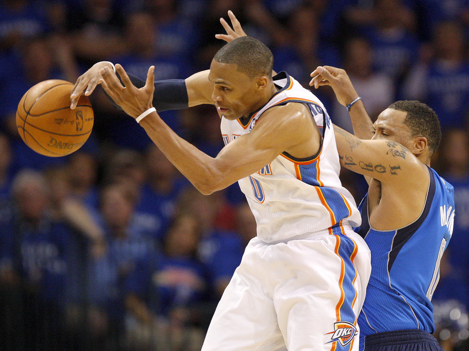 Oklahoma City's Russell Westbrook (0) grabs the ball in front of Shawn Marion (0) of Dallas during game 4 of the Western Conference Finals in the NBA basketball playoffs between the Dallas Mavericks and the Oklahoma City Thunder at the Oklahoma City Arena in downtown Oklahoma City, Monday, May 23, 2011. Photo by Nate Billings, The Oklahoman