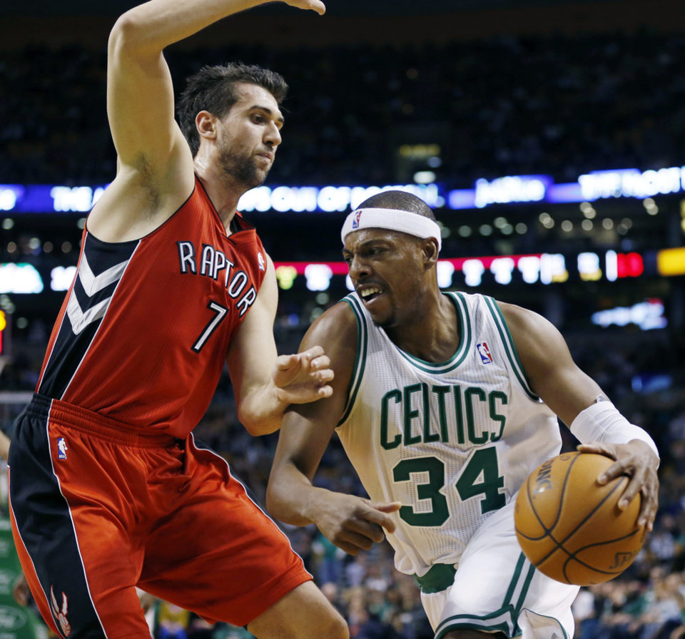 Boston Celtics\' Paul Pierce (34) drives past Toronto Raptors\' Andrea Bargnani (7) in the first quarter of an NBA basketball game in Boston, Saturday, Nov. 17, 2012. (AP Photo/Michael Dwyer)