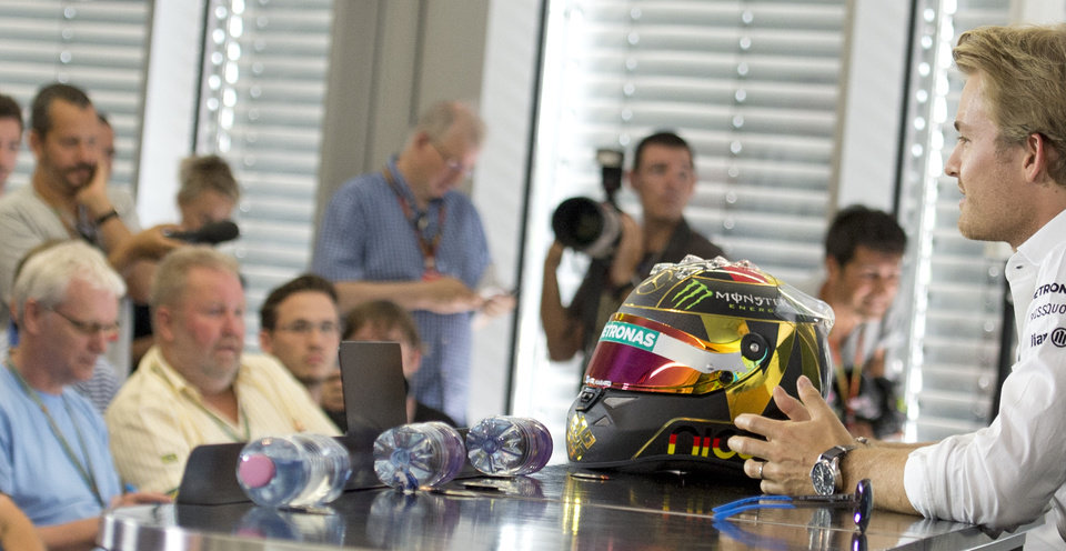 Photo - World Championship leader and Mercedes Formula One driver Nico Rosberg of Germany, right, talks with journalists during a press conference in Hockenheim, Germany, Thursday, July 17, 2014. The German Grand Prix will be held on Sunday, July 20, 2014. (AP Photo/Jens Meyer)