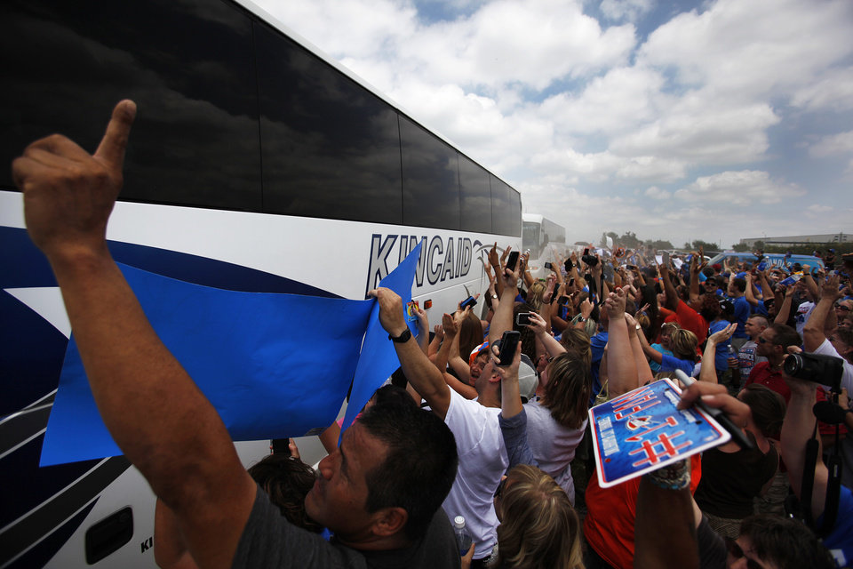 Photo - Oklahoma City Thunder fans welcome a bus carrying Thunder players during a welcome home rally for the Oklahoma City Thunder at a field near Will Rogers Airport in Oklahoma City, Friday, June 22, 2012.  Photo by Garett Fisbeck, The Oklahoman
