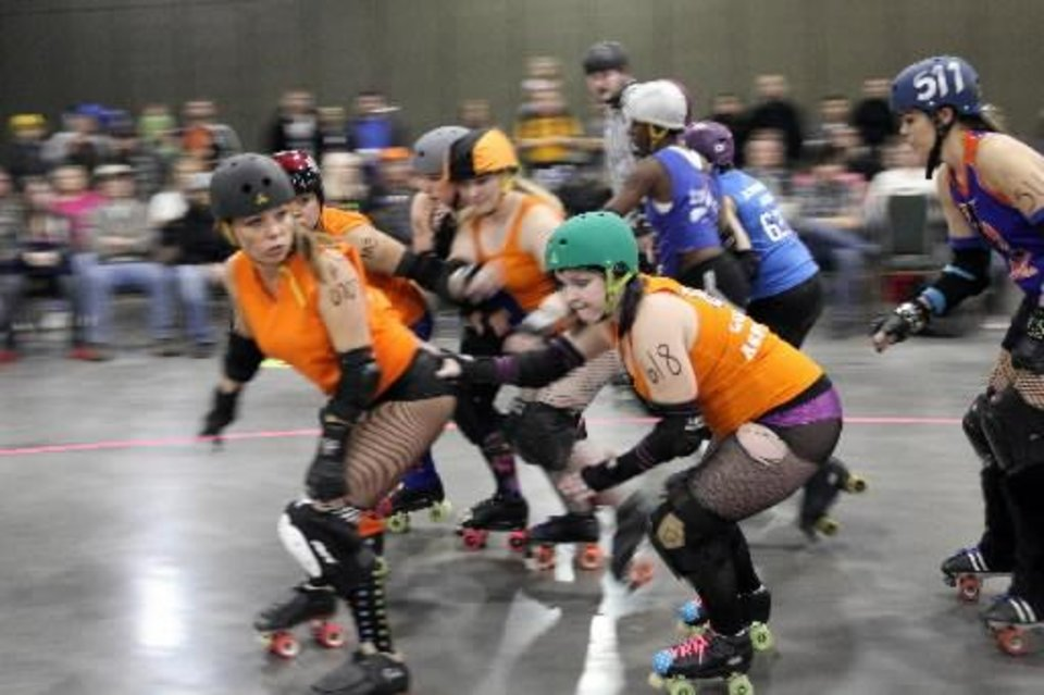 The OKC Roller Girls skate during Opening Night 2012 festivities at the Cox Convention Center in downtown Oklahoma City, Saturday, December 31 2011. Photo by Hugh Scott, The Oklahoman Archives