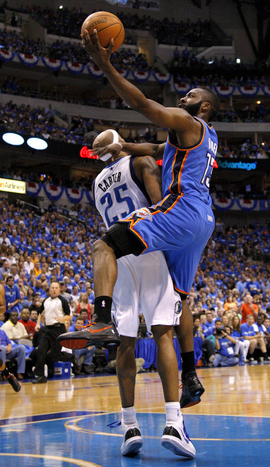 Photo - Oklahoma City's James Harden (13) tries to get past Dallas' Vince Carter (25) during Game 4 of the first round in the NBA playoffs between the Oklahoma City Thunder and the Dallas Mavericks at American Airlines Center in Dallas, Saturday, May 5, 2012. Photo by Bryan Terry, The Oklahoman