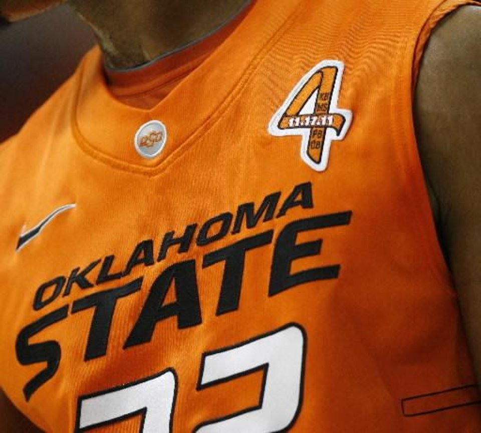Oklahoma State's Markel Brown wears a ribbon in honor of those that were killed in the Nov. 17, 2011, crash during an NCAA men's college basketball game between the Oklahoma State Cowboys (OSU) and the Tulsa Golden Hurricane (TU), at Gallagher-Iba Arena in Stillwater, Okla., Wednesday, Nov. 30, 2011. Photo by Bryan Terry, The Oklahoman