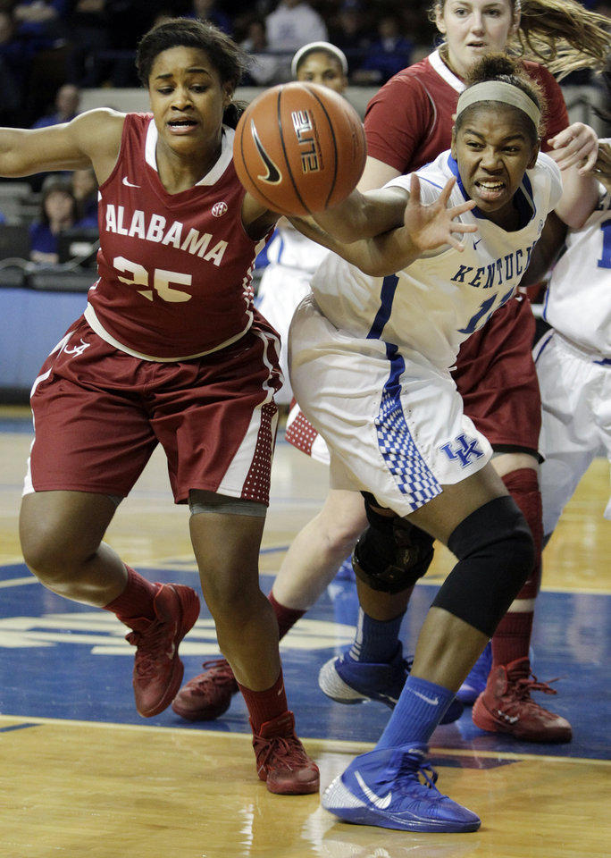 Photo - Kentucky's DeNesha Stallworth, right, and Alabama's Briana Hutchen go after a loose ball during the first half of an NCAA college basketball game, Thursday, Jan. 23, 2014, in Lexington, Ky. (AP Photo/James Crisp)
