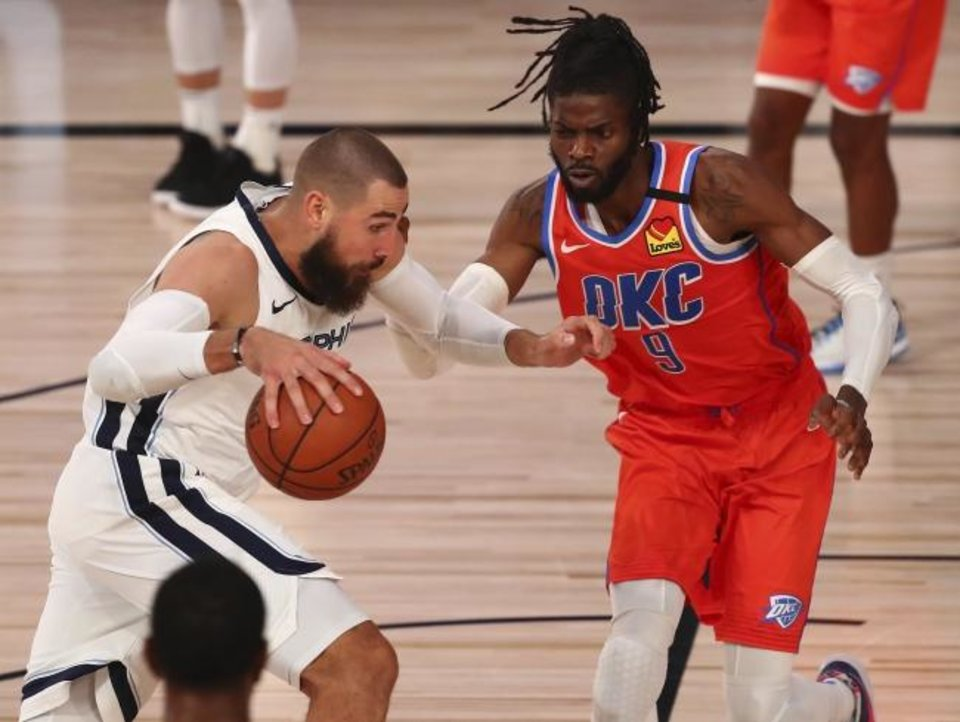 Photo -  Grizzlies center Jonas Valanciunas, left, drives into the paint againstThunder center Nerlens Noel (9) during the second half Friday. Valanciunas scored 19 points on 8-for-11 shooting. [Kim Klement/Pool Photo via AP]