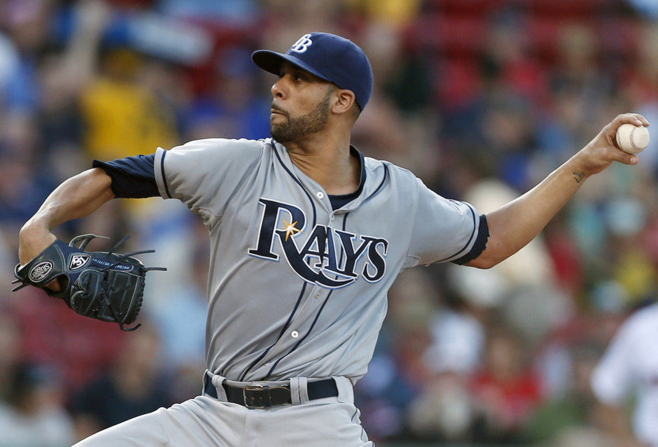 Photo - Tampa Bay Rays' David Price pitches in the first inning of a baseball game against the Boston Red Sox in Boston, Monday, July 29, 2013. (AP Photo/Michael Dwyer)