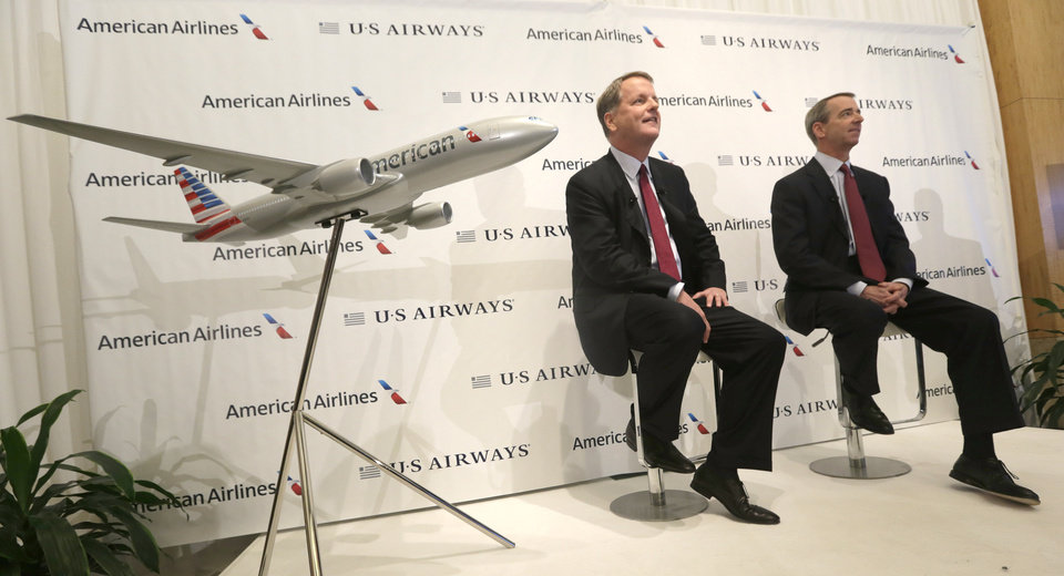 U.S. Airways CEO Doug Parker, left, and American Airlines CEO Tom Horton listen to a question during a news conference at DFW International Airport Thursday, Feb. 14, 2013, in Grapevine, Texas. The two airlines will merge forming the world's largest airlines.  (AP Photo/LM Otero)