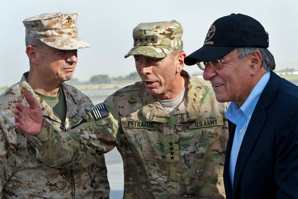 Photo -   FILE POOL - In this July 9, 2011 file photo, USMC Gen. John Allen, left, and Army Gen. David Petraeus, top U.S. commander in Afghanistan and incoming CIA Director, greet former CIA Director and new U.S. Defense Secretary Leon Panetta, right, as he lands in Kabul, Afghanistan, Saturday, July 9, 2011. (AP Photo/Paul J. Richards, Pool)