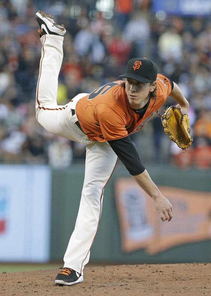 Photo - San Francisco Giants starting pitcher Tim Lincecum throws in the second inning of their baseball game against the Arizona Diamondbacks, Friday, July 11, 2014, in San Francisco. San Francisco won the game 5-0 and Lincecum was the winning pitcher. (AP Photo/Eric Risberg)