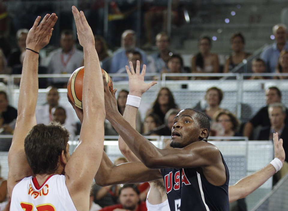 United States Kevin Durant, right, shoots over Spain's Rudy Fernandez during the Americans' 86-85 win in Madrid on Sunday. AP PHOTO