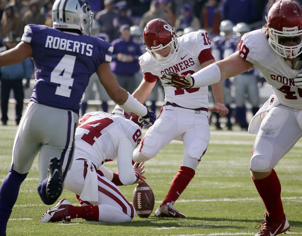 Oklahoma's Michael Hunnicutt (18) kicks a field goal during an NCAA college football game between the Oklahoma Sooners and the Kansas State University Wildcats at Bill Snyder Family Stadium in Manhattan, Kan., Saturday, Nov. 23, 2013. Oklahoma won 41-31. Photo by Bryan Terry, The Oklahoman